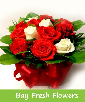 red and white roses in a box