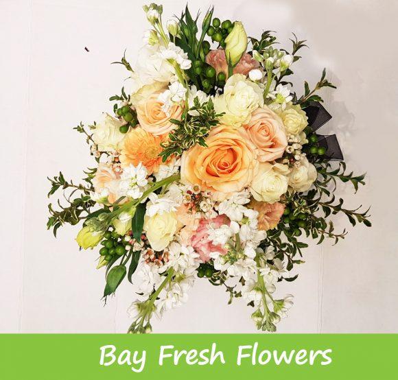 cream flowers in a vase